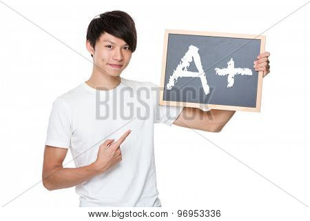 Man hold with chalkboard showing A plus mark