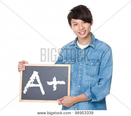 Man hold with blackboard showing A plus mark
