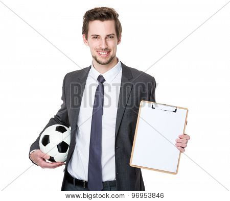Soccer couch hold with soccer ball and clipboard