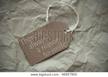 One Beige Label Or Tag With White Ribbon On Crumpled Paper Background. English Life Quote There Is Always A Reason To Smile Vintage Or Retro Style With Frame poster