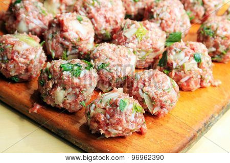 Raw Meatballs On The Chopping Board