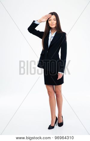 Full length portrait of a beautiful businesswoman saluting isolated on a white background