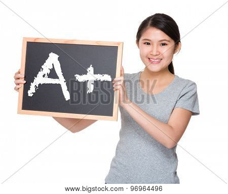 Young student hold with black board showing A plus mark