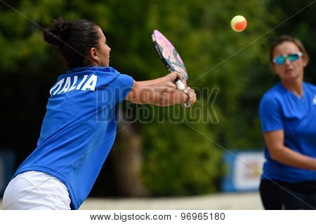 MOSCOW, RUSSIA - JULY 17, 2015: Sofia Cimatti (left) and Eva d'Elia of Italy in action during the ITF Beach Tennis World Team Championship. 28 nations compete in the event this year