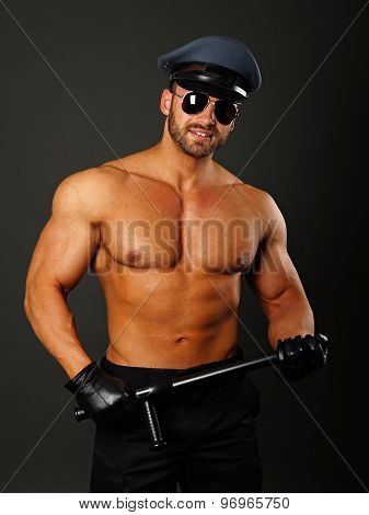 Muscular policeman with nightstick