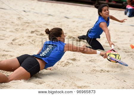MOSCOW, RUSSIA - JULY 17, 2015: Patricia Diaz (left) and Lady Correa of Venezuela in action during the ITF Beach Tennis World Team Championship. 28 nations compete in the event this year