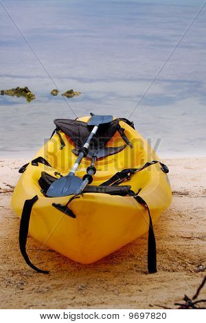 Yellow kayak on beach in Belize