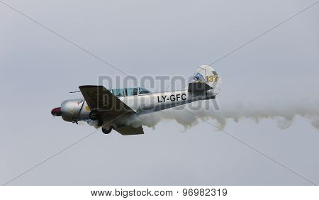 Thiene, Vicenza - Italy. 26Th July, 2015: Aircraft With Two Pilots And Smoke