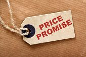 The words Price Promise in red text on a label or tag with string and brown wrapping paper poster