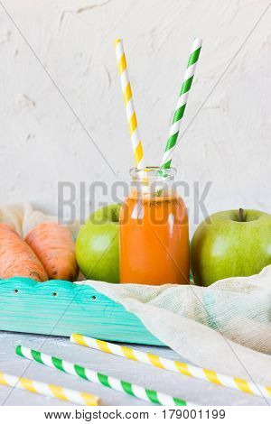 Freshly squeezed carrot and apple juice. Country style photo