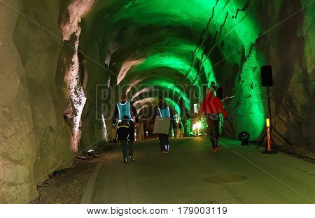 STOCKHOLM SWEDEN - MAR 25 2017: Rear view of seniors walking in a steep ascent in the Stockholm Tunnel Run Citybanan 2017. March 25 2017 in Stockholm Sweden