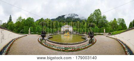 Panorama Of The Linderhof Palace. Fountain Group Flora And Puttos