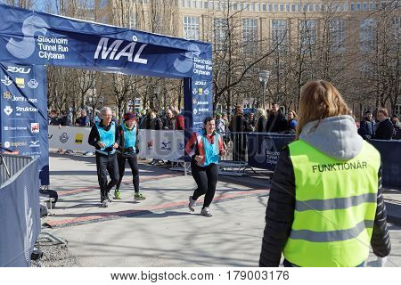 STOCKHOLM SWEDEN - MAR 25 2017: Group of senior runners passing the finish line in the Stockholm Tunnel Run Citybanan 2017. March 25 2017 in Stockholm Sweden