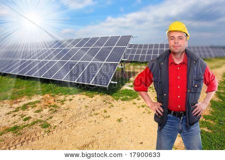 Engineer against solar panels.