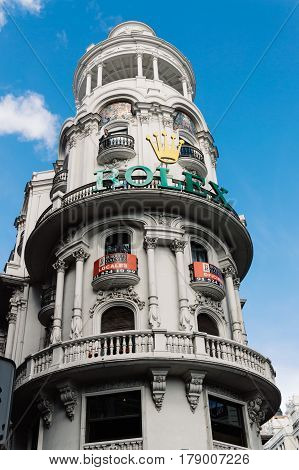 Madrid Spain - September 18 2016: Low angle view of buildings at Gran Via Street in Madrid. Dome in penthouse. It is an important street in Central Madrid with shops and theaters.