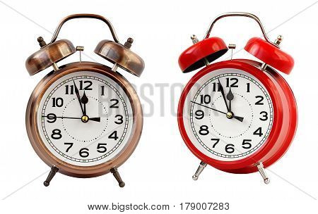 Retro the alarm clock of bronze & red color at twelve o'clock isolated on a white background. Midnight midday. Minutes about New year.