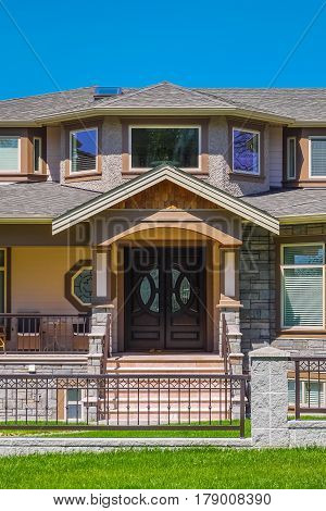 Entrance of luxury residential house with metal fence in front