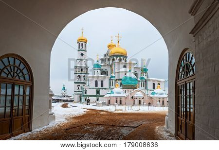 The new Jerusalem monastery Istra, Russia view through the Central arch entrance to the monastery and the road in the winter