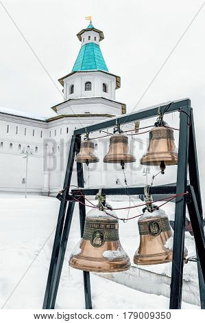 New Jerusalem monastery, Istra, Russia, the bells and bell tower vertically in winter in cloudy weather