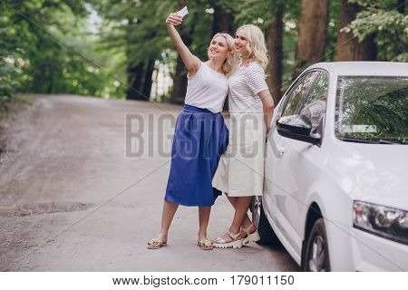 young beautiful twins, walk and enjoy the beautiful weather