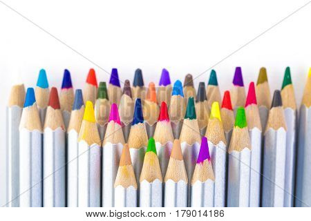 set of many different colored pencils on white background