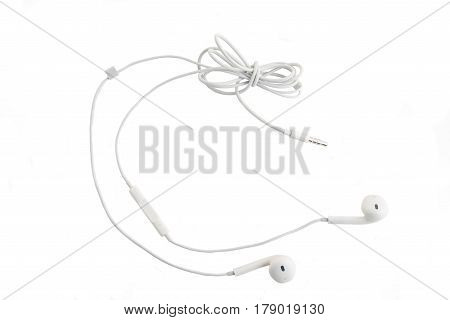 White headphones with headset lie on white isolated background