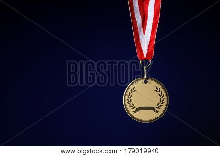 Sporting a winner's medal on a black background closeup.