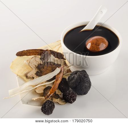 Chinese Traditional Herbs And Medicine Soup On Background.