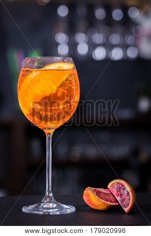 Cocktail on the wooden table with orange