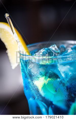 Blue Lagoon cocktail with a slice of lemon