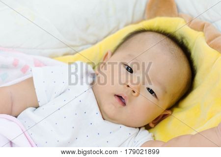 Cute Asian Baby Laying On Bed, Just Woke Up