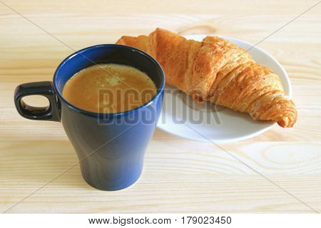 One Cup of Coffee with a Butter Croissant Served on White Plate