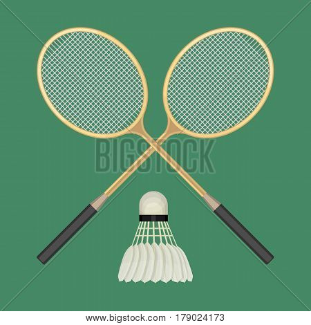 Two crossed badminton rackets and white shuttlecock with black line. Vector illustration of equipments for badminton game sport isolated on green background in flat design. Rackets and shuttlecock