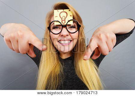 Woman Having Light Bulb Mark On Forehead Thinking