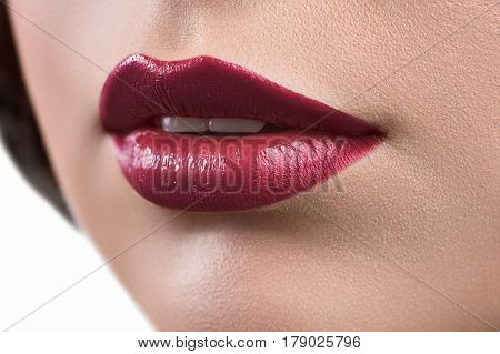 Lips makeup. Close up studio shot of a young woman wearing vinous lipstick lips mouth sexy sexuality sensual sensuality skincare professional makeup perfection unblemished color fashionable concept
