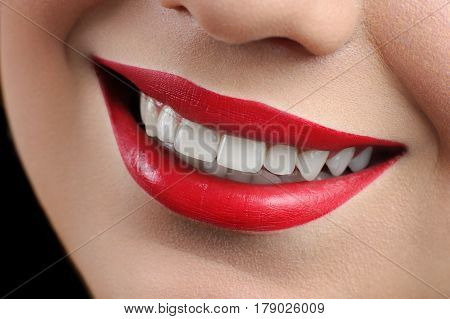 Perfect smile Cropped close up of a happy beautiful woman with red lips and healthy perfect white teeth smiling happily health beauty cosmetology dentistry perfection femininity makeup concept.