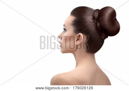 Beauty in simplicity. Rearview shot of a beautiful young woman with gorgeous shiny hair in a bun isolated on white copyspace salon cosmetology skincare health treatment recreation medical concept