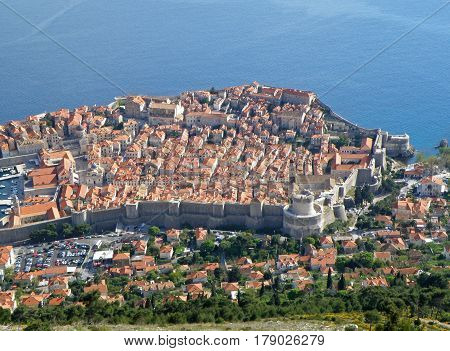Stunning aerial view of Dubrovnik old city and vibrant blue Adriatic Sea as seen from Mt. Srd Hilltop, Croatia poster