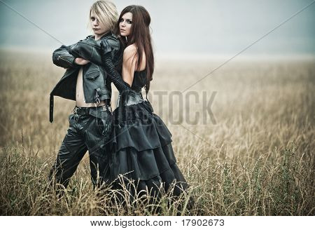 Young goth couple outdoors portrait.