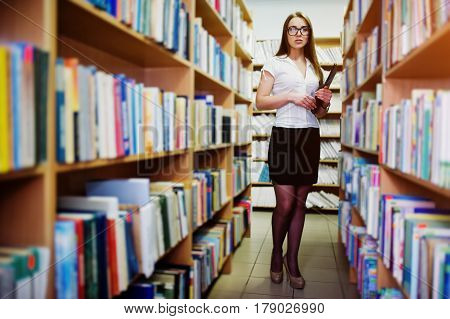 Brunette Girl On Glasses At Library With Folder Of Documents, Wear On White Blouse And Black Mini Sk