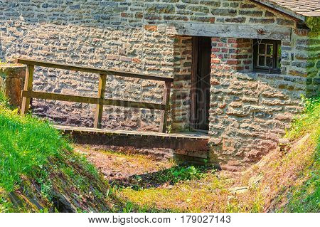 Idyllic Alpine shelter or chalet in summer on a mountain meadow.