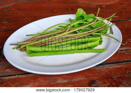 Vegetable morning glory and long bean for Famous Thai food, papaya salad or SOM TAM or Somtum. on wooden table.