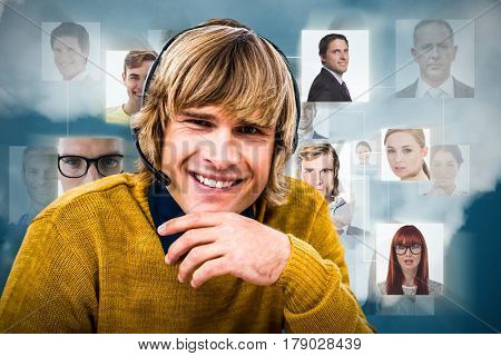 Smiling hipster businessman using headset against dark blue background