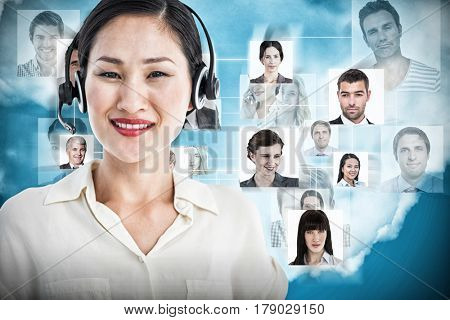 Beautiful smiling female executive with headset against blue background