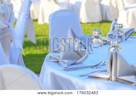 wedding chair and table setting for fine dining at outdoors on the garden.