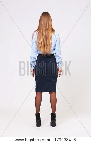 Full Body Studio Shot From Behind Of Young Business Woman On Gray Background.