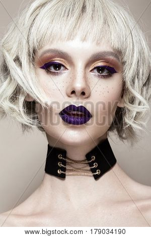 Beautiful funny girl in a white wig, with creative art make-up and freckles. Beauty face. Photo taken in studio