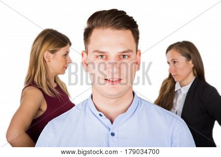 Portrait of a stressed young guy two jealous women fighting in the background