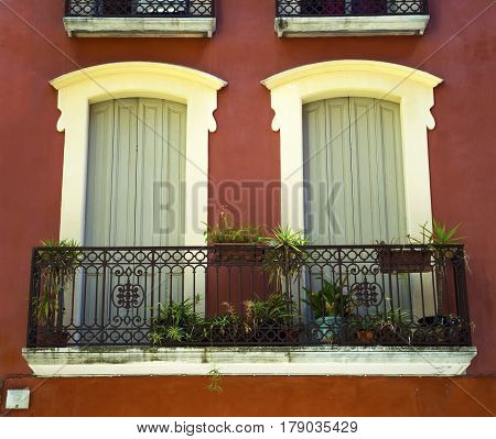 Balcony with plants in the city center of the Perpignan in southeastern France
