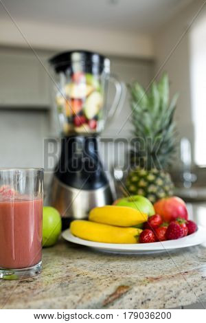 View of a glass of homemade smoothie on the counter of the kitchen